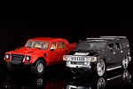 The Lamborghini LM002 next to the more modern Hummer H2