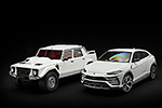 The white over red Lamborghini Urus next to the LM002 in a similar color combination